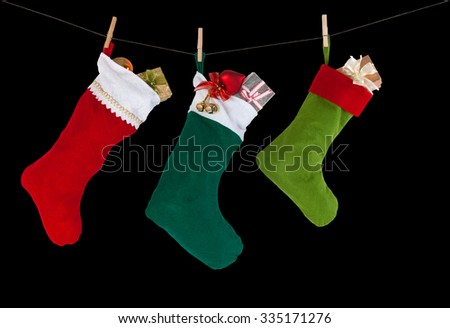 colorful xmas socks. red, green, dark green color. rope with clothespins. design decoration element, isolated - stock photo