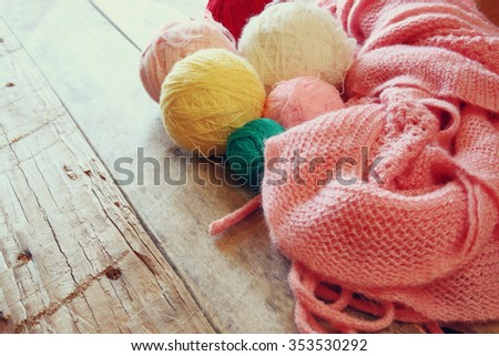 colorful yarn balls of wool on wooden table  - stock photo