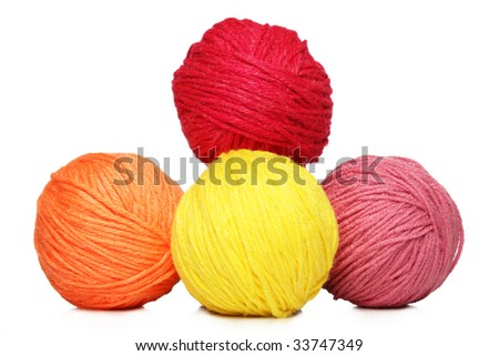 Colorful yarn balls over white