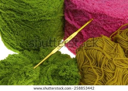Colorful yarn for crocheting and hook isolated on white background