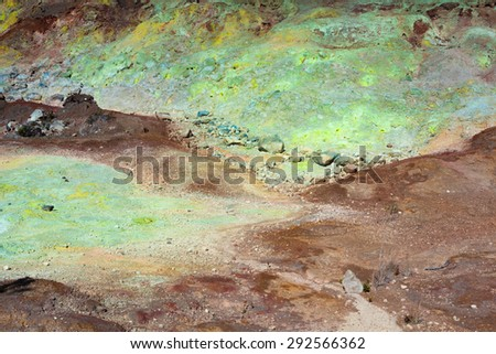 Colorful  yellow, blue and green geological sulfur deposits along the trail in Hawaii Volcanoes National Park, Big Island, Hawaii - stock photo