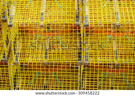 Colorful yellow stacked lobster traps make a unique abstract on Orr's Island in a working Maine Harbor - stock photo
