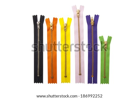 Colorful zipper collection isolated over white - stock photo