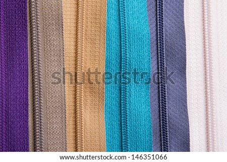 Colorful zippers - stock photo