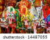 Colorfull Chinese lunar new year's dragons hanging in front of a store with good fortune quotes. - stock photo
