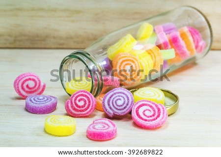 Colorfull Jelly  on wooden background   - stock photo