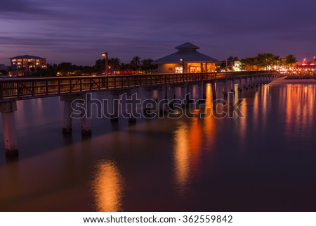 Colorfull lights after sunset on the fishing pier in Fort Myers Beach, Gulf of Mexico Coast, Florida. - stock photo