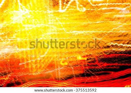 Colorfull lights of urban surrounding blurred by motion