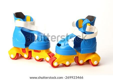 Colorfull plastic roller skates on white background.       - stock photo