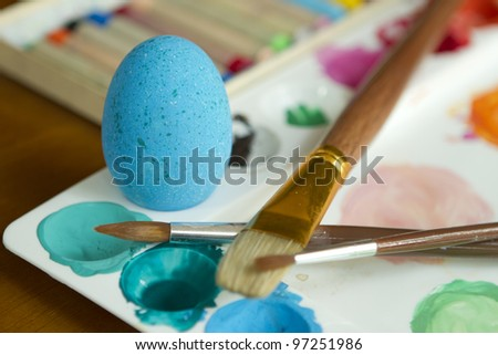 Coloring colorful easter eggs - stock photo