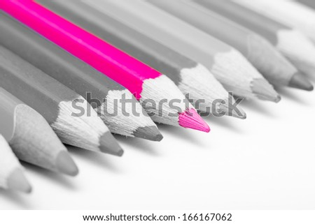 Coloring Crayon Stepping Up From The Others Concept - stock photo