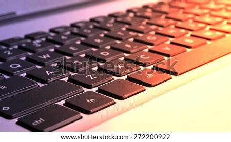Colorized computer (notebook) keyboard close-up view - stock photo