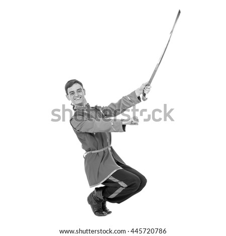 colorless portrait of Russian cossack dance. Young dancer posing with sword