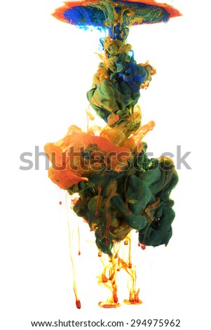 Colors drop underwater. Liquid colors in central composition. Isolated on white background. Green, orange and yellow color mix. Organic structures.