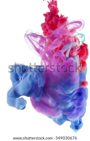 Colors drop underwater. Liquid colors in central composition. Isolated on white background. Organic structures. Colorful abstract composition. Color mixing.  - stock photo