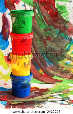 colors for painting on child painted background - stock photo