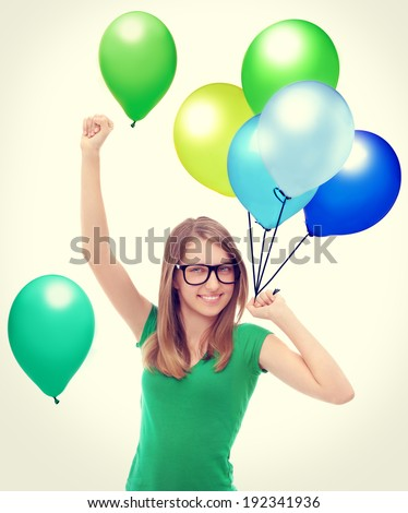 Colors.Laughing girl holding a balloon .White background - stock photo