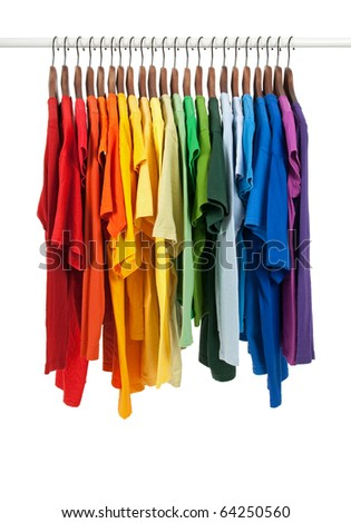 Colors of rainbow. Variety of casual shirts on wooden hangers, isolated on white. - stock photo