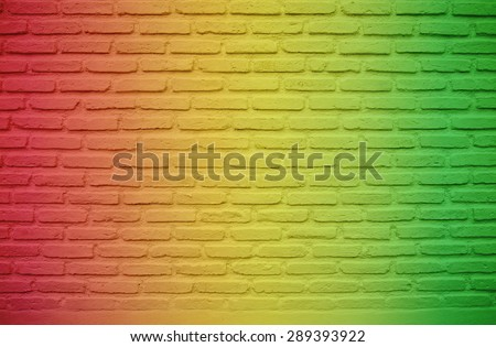 Colors of reggae music on brick wall background - stock photo