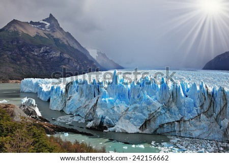 Colossal Perito Moreno glacier in Lake Argentino. Los Glaciares National Park in Patagonia. Sunny summer day - stock photo