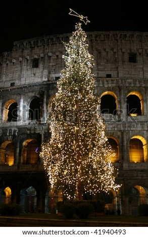 Colosseo with a christmas tree at night (Rome, Italy) - stock photo