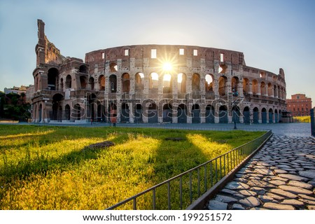 Colosseum against colorful sunset in Rome, Italy - stock photo