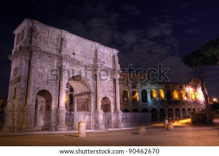 Colosseum and Arch of Constantine at night,  Rome - stock photo