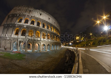 Colosseum at Night, Rome - Wide Angle view with car light trails - Italy - stock photo