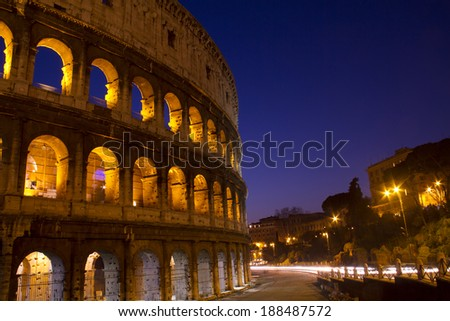 Colosseum in Rome, Italy at night with trails from traffic - stock photo