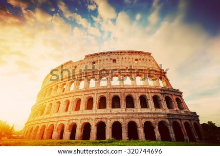 Colosseum in Rome, Italy. Symbol of the ancient city. Amphitheatre in sunrise light. Vintage - stock photo
