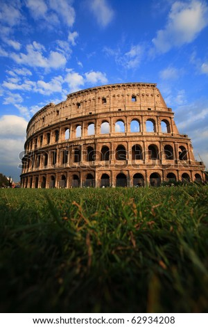 Colosseum in Rome, Italy, with blue sky - stock photo