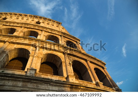 Colosseum in Rome with blue sky at day.