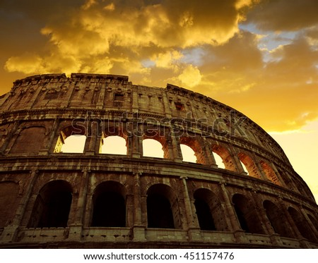 Colosseum in Rome with sunset sky in the background, Italy - stock photo