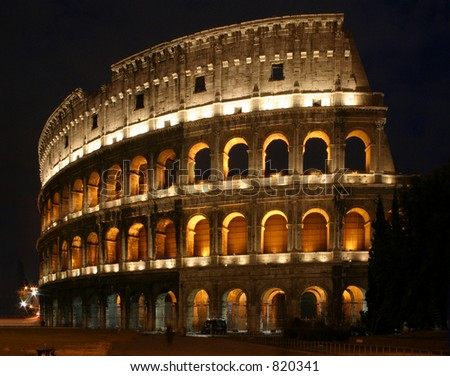 Colosseum: The Roman Colosseum at night. - stock photo
