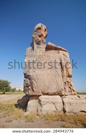 Colossi of Memnon. Statues of Pharaoh Amenhotep III. Valley of Kings, Luxor, Egypt - stock photo