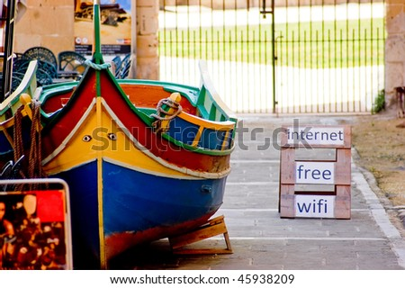 colour boat in malta with the free wifi internet advertisement - stock photo