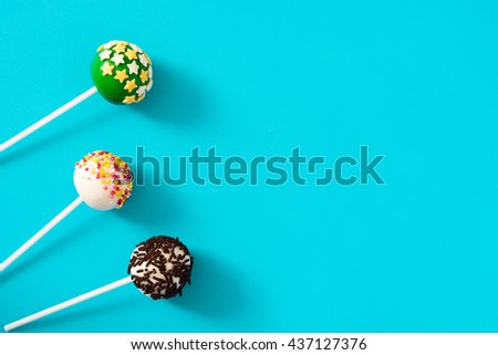Colour Cake pops on blue background   - stock photo