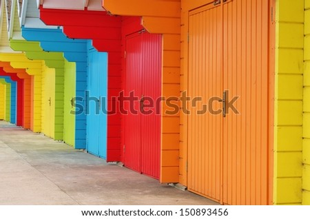 colour paint wooden Victorian beach hut at the seaside - stock photo