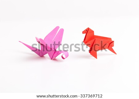 colour paper origami. Paper origami bird isolated on white background. - stock photo