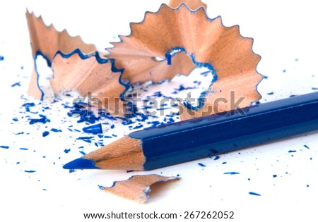 Colour pencils isolated on white background close up pencil sharpening remains - stock photo