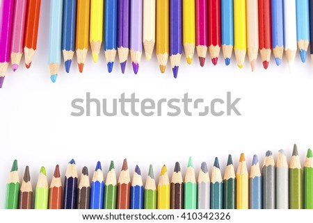 colour pencils on white background - stock photo