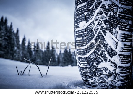 Colour picture of a snow tire in winter - stock photo