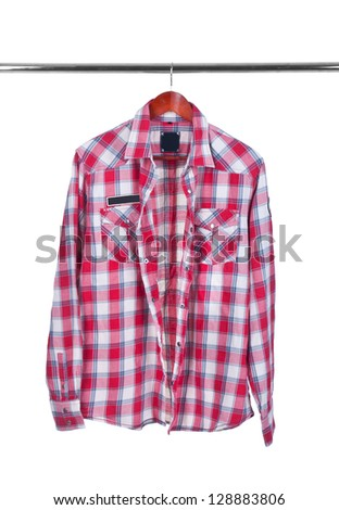 Colour shirt on wooden hanger isolated on white - stock photo