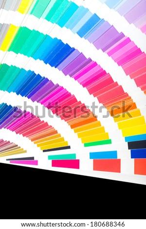 Colour swatches book. Rainbow Pantone sample colors catalogue. - stock photo