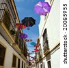 Colour telescopic umbrellas on street of old Cordoba, Spain, Andalusia - stock photo
