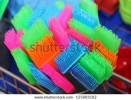 coloured brushes with plastic and silicone bristles to decorate cakes and buns - stock photo