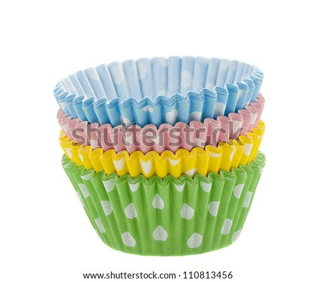 coloured cupcake baking cups on white background - stock photo