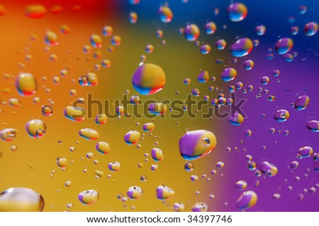 coloured drops of water on the coloured background - stock photo