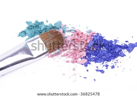 Coloured eyeshadows with professional make-up brush - stock photo