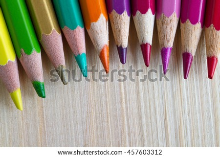 coloured pencil on the wood floor. - stock photo